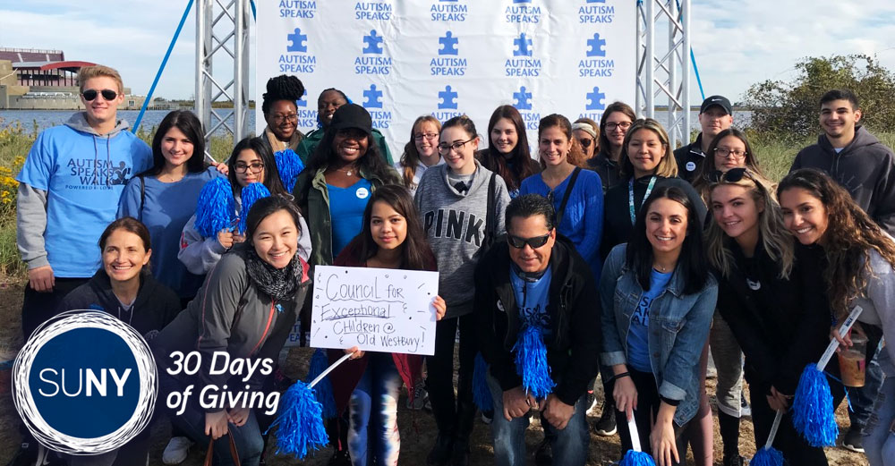 SUNY Old Westbury students and staff pose at the Long Island Autism Walk at Jones Beach.