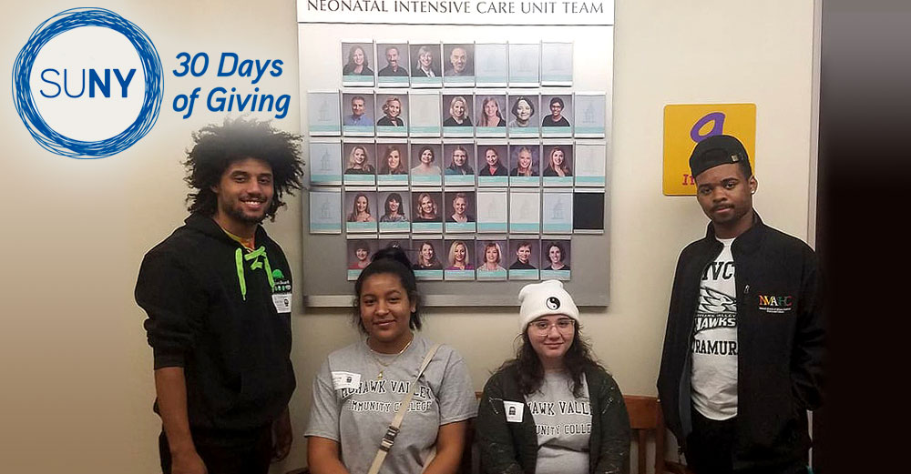 Mohawk Valley Community College students along a wall at an area NICU center