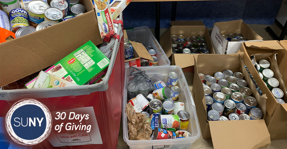 Boxes of canned and boxed food donations.