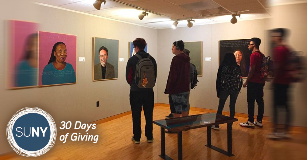 SUNY Poly students gather iin art gallery to look at exhibits.