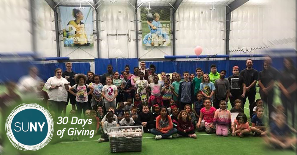 Niagara County Community College students with kids from the Niagara Falls Boys & Girls Club afterschool program.