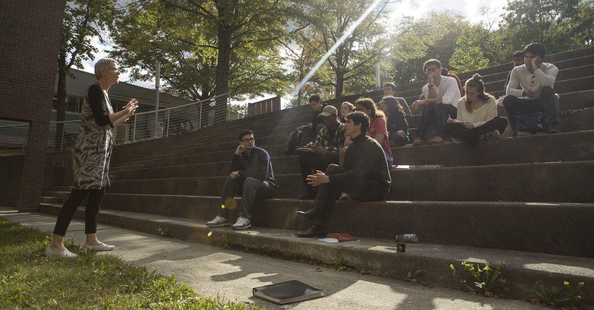Students at SUNY Purchase sitting outside