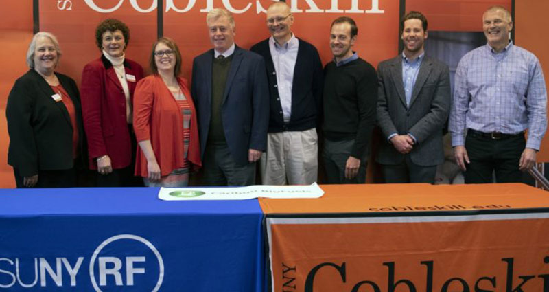 Staff from SUNY Cobleskill, the SUNY Research Foundation, and Caribou Biofuels stand together.