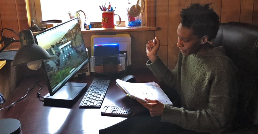 Student in her home bedroom during a distance learning session.