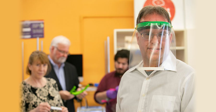 Stony Brook University staff wears 3D printed mask made in campus iCREATE lab.