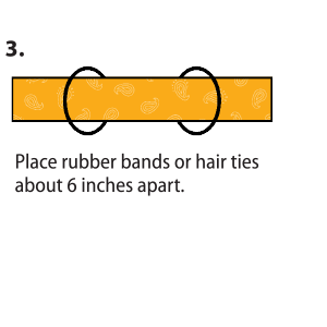 Rectangle cloth clip art with instructions to Place rubber bands or hair ties about 6 inches apart.