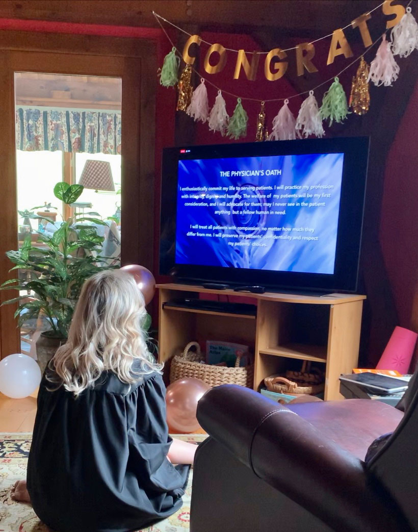 Mary Beth Gadarowski watches the physician's oath during her virtual commencement from SUNY Upstate Medical University