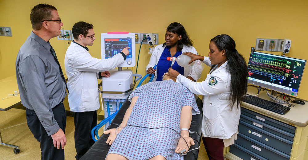 Respiratory Therapy students work on a dummy body to learn proper treatment techniques.