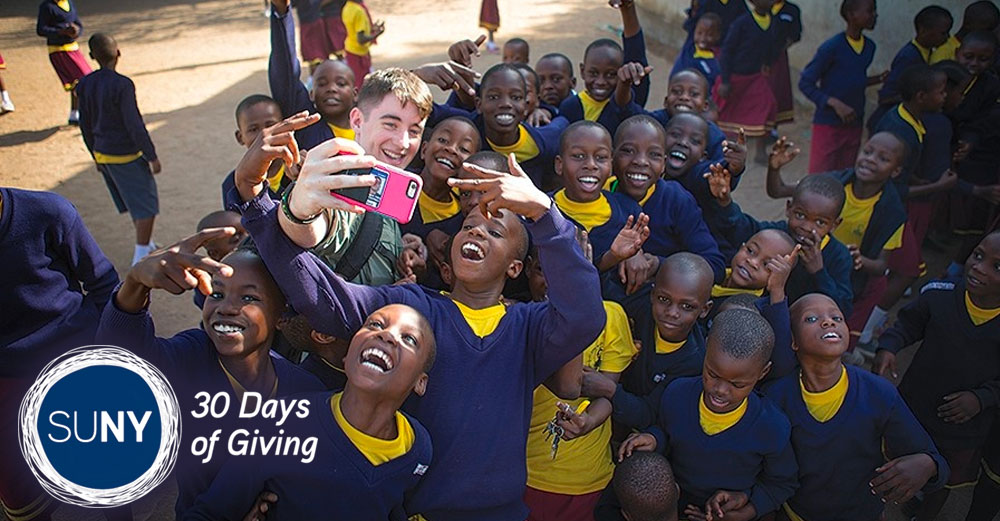 UB student Dylan McCaffrey takes a selfie with local schoolchildren during a visit to Tanzania in 2017. Photo: Douglas Levere