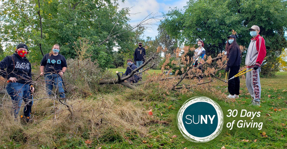 SUNY ESF students outside doing maintenance and cleanup of Thorden Park