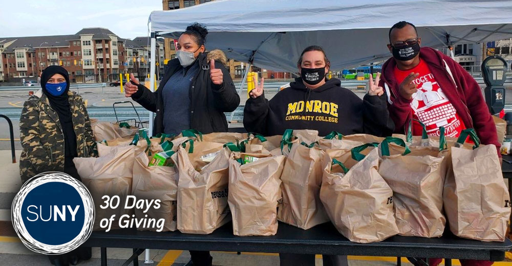 Students and staff from Monroe Community College distribute meal kits at Turkey Drop at Downtown Campus