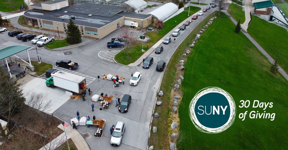 Cars line up for a dairy food drive at SUNY Morrisville
