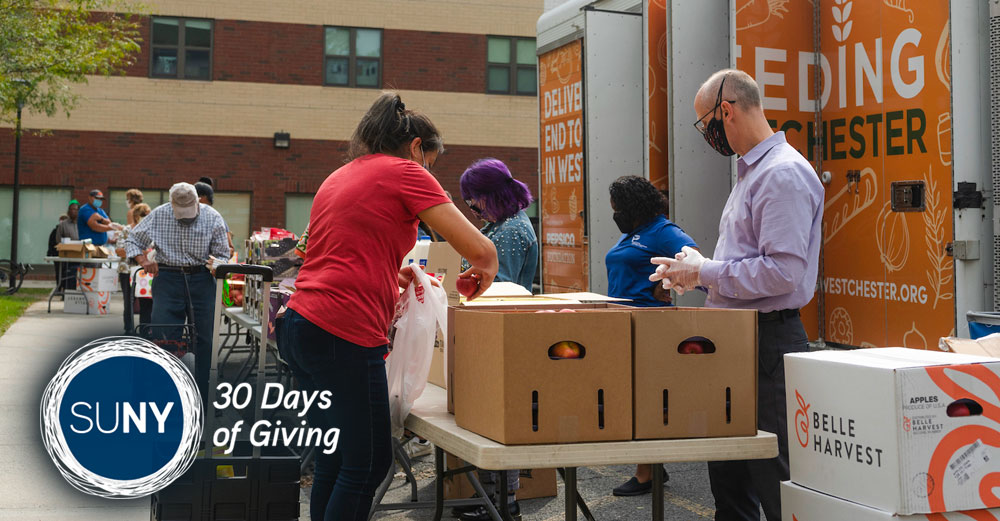 Tables for a mobile food pantry is set up outside at SUNY Purchase.