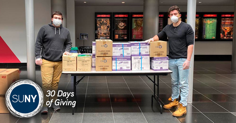 Pano Sourlis (left) and Vincent DeStefano (right) with donations from local school districts that they delivered to the Wang Center for Stony Brook University Hospital's frontline workers