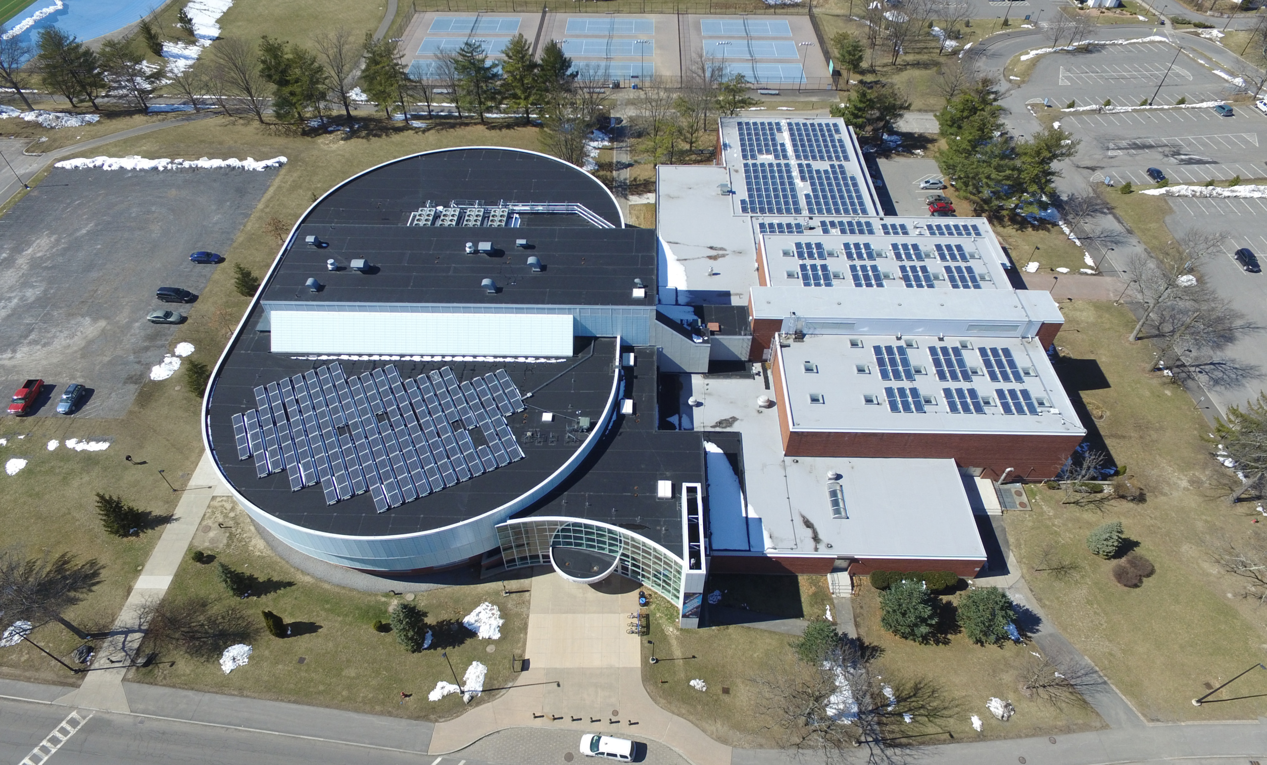 An aerial view of solar arrays on a SUNY New Paltz building rooftop.